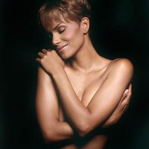 Halle Berry naked covering breasts