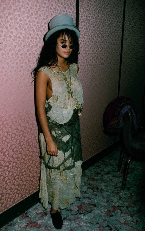 A young Lisa Bonet in boho chic skirt and hat