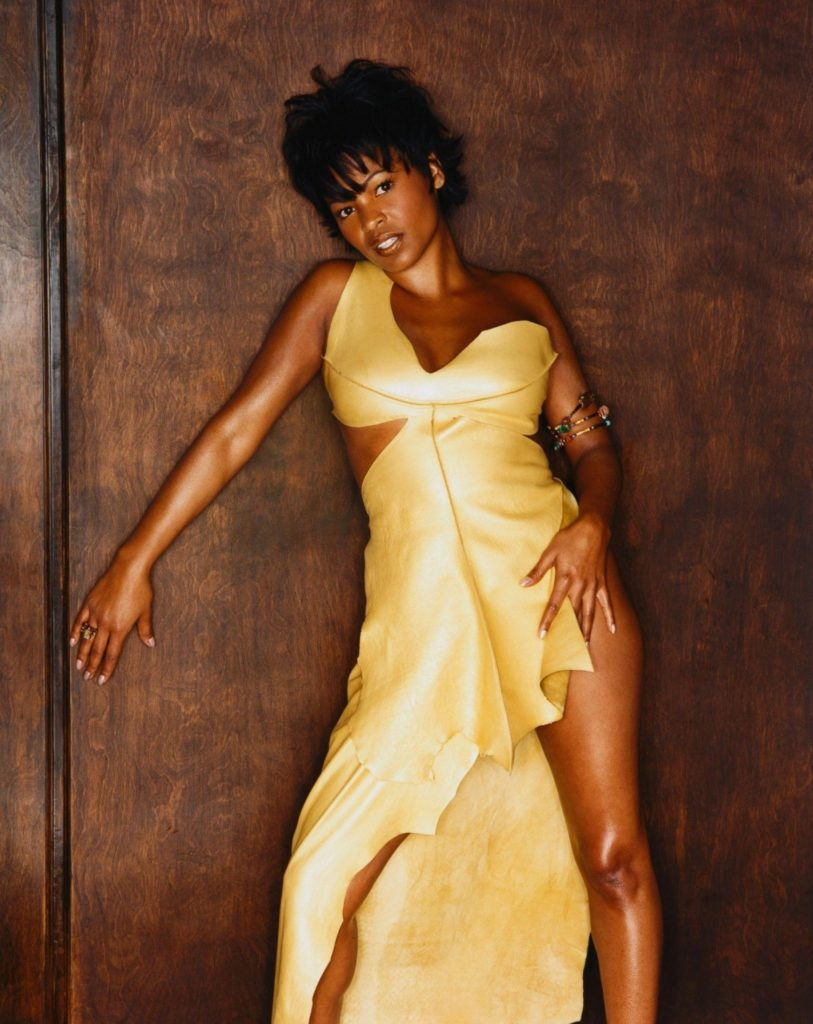 Nia Long looking sexy and showing her legs in gold dress