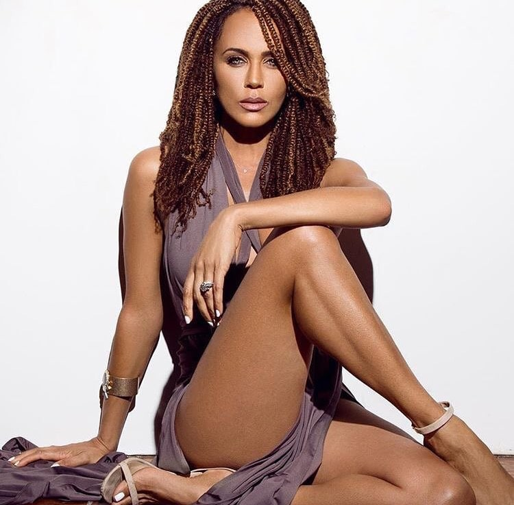 Nicole Ari Parker looking sexy sitting down