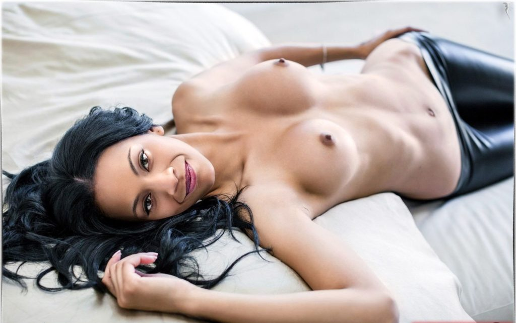 Zoe topless in bed