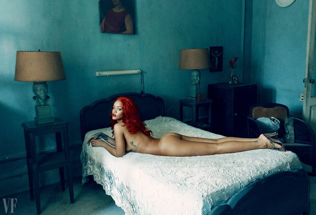 Rihanna laying naked in bed