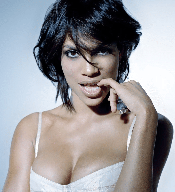 Rosario Dawson with finger in her mouth