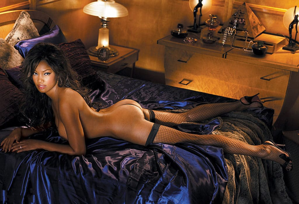 Garcelle Beauvais on her stomach in thigh highs (Playboy)