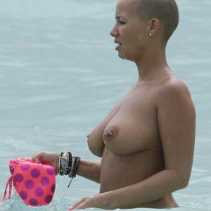Amber in the ocean with her top off (2)