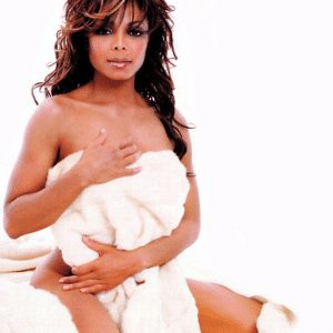 Janet Jackson covering herself with a blanket