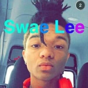 snapchat photo of swae lee in his care with dre headphones on